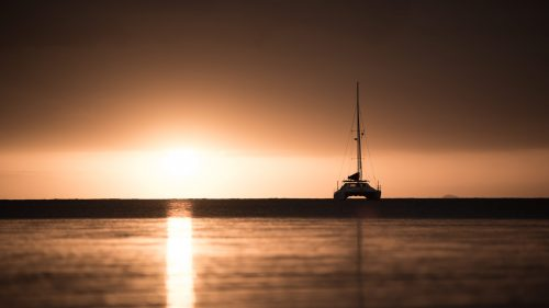 A catamaran in the sunset of New Caledonia